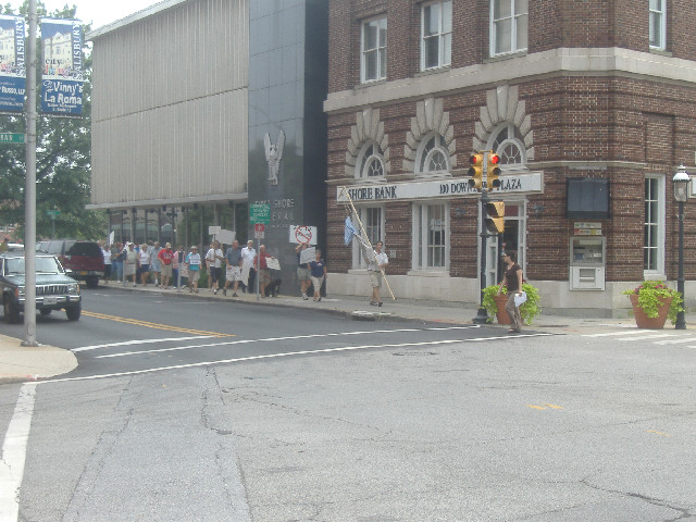The protestors began their impromptu march in the library parking lot and walked the two blocks to Congressman Frank Kratovil's Salisbury regional office.