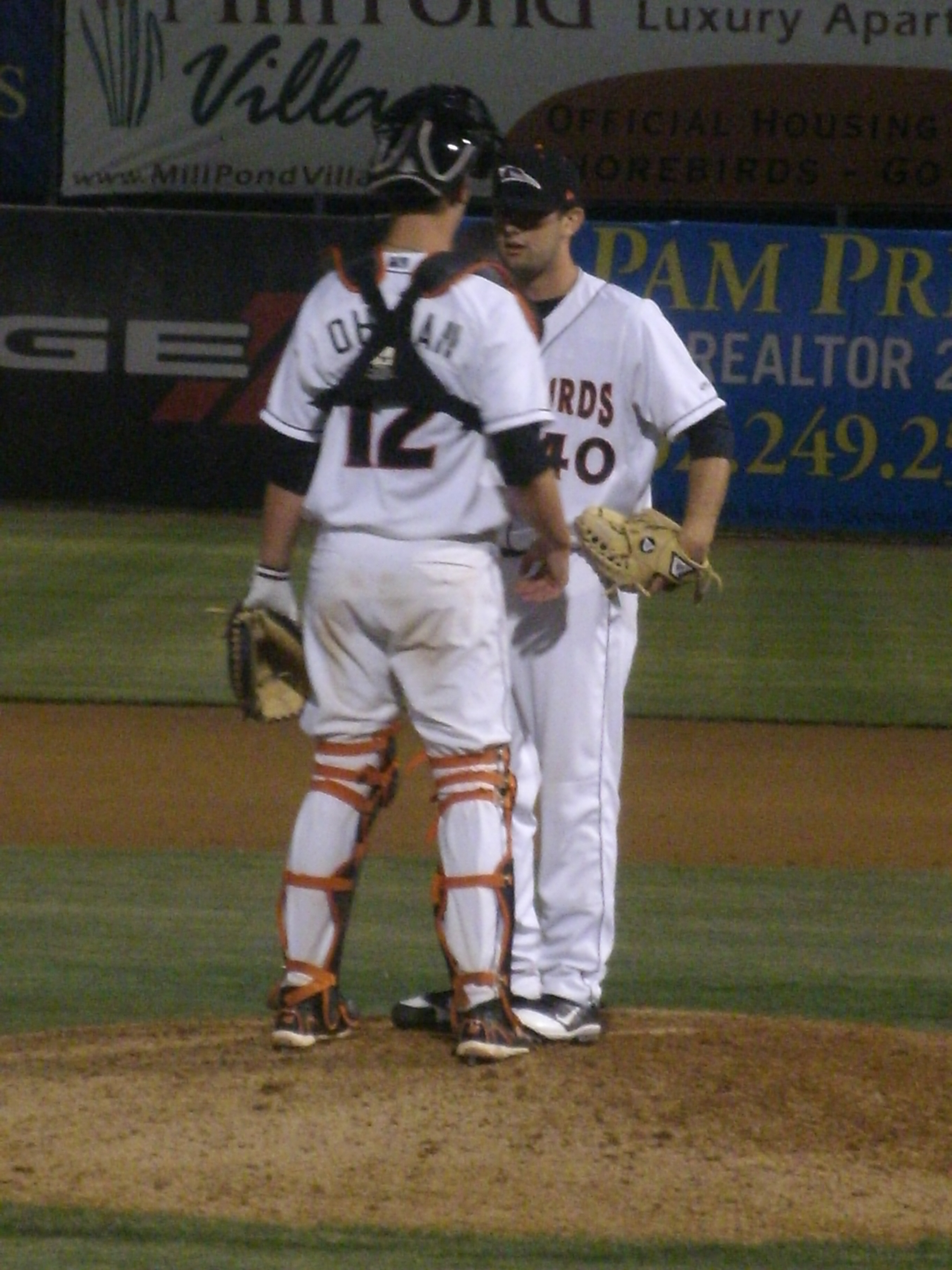David Walters is instructed by catcher Michael Ohlman before taking the mound and earning the save against Savannah April 27.
